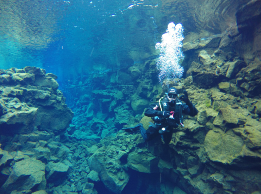 Diving between tectonic plates at Silfra, Iceland