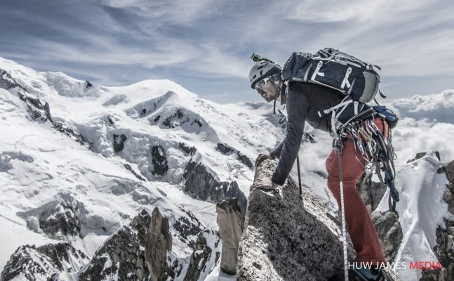 Topping out on the Rebuffat Bouquet route on the South face of the Aiguille du Midi in the French Alps