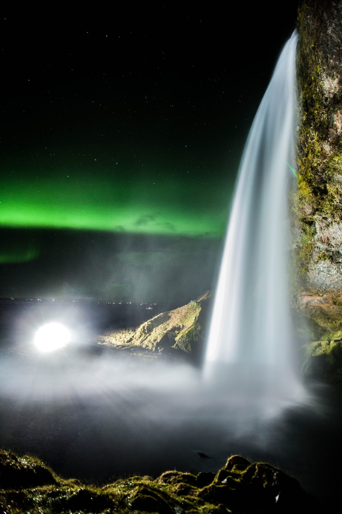 Seljalandfoss looks incredible at night, especially with some aurora in the background! What an exped so far on #AnturusIceland!